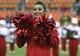 Nov 23, 2013; Houston, TX, USA; A Houston Cougars cheerleader performs before a game against the Cincinnati Bearcats at BBVA Compass Stadium. Mandatory Credit: Troy Taormina-USA TODAY Sports