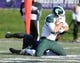Nov 23, 2013; Evanston, IL, USA; Michigan State Spartans tight end Josiah Price (82) scores a touchdown during the second half against the Northwestern Wildcats at Ryan Field. Michigan State won 30-6. Mandatory Credit: Reid Compton-USA TODAY Sports