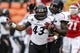 Nov 23, 2013; Houston, TX, USA; Cincinnati Bearcats linebacker Nick Temple (43) and defensive end Terrell Hartsfield (95) celebrate after a defensive play during the first quarter against the Houston Cougars at BBVA Compass Stadium. Mandatory Credit: Troy Taormina-USA TODAY Sports