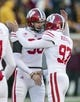 Nov 23, 2013; Minneapolis, MN, USA; Wisconsin Badgers kicker Jack Russell (97) and punter Drew Meyer (90) celebrate after making a field goal in the first quarter against the Minnesota Golden Gophers at TCF Bank Stadium. Mandatory Credit: Jesse Johnson-USA TODAY Sports