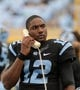 Nov 23, 2013; Chapel Hill, NC, USA; North Carolina Tar Heels quarterback Marquise Williams (12) talks on a phone during the second half against the Old Dominion Monarchs at Kenan Memorial Stadium. The Tar Heels won 80-20.  Mandatory Credit: Rob Kinnan-USA TODAY Sports