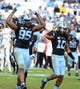 Nov 23, 2013; Chapel Hill, NC, USA; North Carolina Tar Heels defensive end Kareem Martin (95) celebrates a second half sack against the Old Dominion Monarchs with teammate Tre Boston (10) at Kenan Memorial Stadium. The Tar Heels won 80-20.  Mandatory Credit: Rob Kinnan-USA TODAY Sports