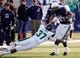 Nov 23, 2013; Logan, UT, USA; Utah State Aggies running back Joey DeMartino (28) spins out of a tackle by Colorado State Rams linebacker Aaron Davis (37) during the first quarter at Romney Stadium. Mandatory Credit: Chris Nicoll-USA TODAY Sports