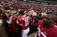 Nov 23, 2013; Tuscaloosa, AL, USA; Alabama Crimson Tide quarterback A.J. McCarron (10) stops to hug his mother Dee Dee Bonner as he made a victory lap around the stadium with teammates and wide receiver Kevin Norwood (83) after their 49-0 win over the Chattanooga Mocs at Bryant-Denny Stadium. This was McCarron's final home game of his senior year. Katherine Webb the girlfriend of McCarron is seen far left. Mandatory Credit: John David Mercer-USA TODAY Sports