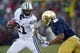 Nov 23, 2013; South Bend, IN, USA; BYU Cougars running back Jamaal Williams (21) carries the ball as Notre Dame Fighting Irish cornerback KeiVarae Russell (6) defends in the first quarter at Notre Dame Stadium. Mandatory Credit: Matt Cashore-USA TODAY Sports