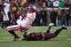 Nov 23, 2013; Minneapolis, MN, USA; Minnesota Golden Gophers defensive back Antonio Johnson (11) tackles Wisconsin Badgers tight end Jacob Pedersen (48) after making a catch in the second quarter at TCF Bank Stadium. Mandatory Credit: Jesse Johnson-USA TODAY Sports