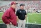 Nov 23, 2013; Tallahassee, FL, USA; Florida State Seminoles head coach Jimbo Fisher meets with Idaho Vandals head coach Paul Petrino before the start of the game at Doak Campbell Stadium. Mandatory Credit: Melina Vastola-USA TODAY Sports