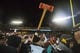 Nov 23, 2013; Minneapolis, MN, USA; A general view of the Paul Bunyon Axe being held in the air by the Wisconsin Badgers after defeating the Minnesota Golden Gophers at TCF Bank Stadium. The Badgers won 20-7. Mandatory Credit: Jesse Johnson-USA TODAY Sports