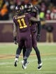 Nov 23, 2013; Minneapolis, MN, USA; Minnesota Golden Gophers defensive back Antonio Johnson (11) and defensive back Martez Shabazz (3) celebrate after making a stop on fourth down against the Wisconsin Badgers in the second half at TCF Bank Stadium. The Badgers won 20-7. Mandatory Credit: Jesse Johnson-USA TODAY Sports