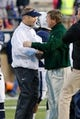 Nov 23, 2013; Logan, UT, USA; Utah State Aggies head coach Stew Morrill and Colorado State Rams head coach Jim McElwain shake hands in the middle of the field after the game at Romney Stadium. Utah State Aggies won 13-0. Mandatory Credit: Chris Nicoll-USA TODAY Sports
