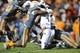 Nov 23, 2013; Knoxville, TN, USA; Tennessee Volunteers linebacker A.J. Johnson (45) and defensive lineman Corey Miller (80) tackle Vanderbilt Commodores quarterback Patton Robinette (4) during the second quarter at Neyland Stadium. Mandatory Credit: Randy Sartin-USA TODAY Sports