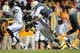 Nov 23, 2013; Knoxville, TN, USA; Tennessee Volunteers linebacker A.J. Johnson (45) tackles Vanderbilt Commodores running back Wesley Tate (24) during the second quarter against the Tennessee Volunteers at Neyland Stadium. Mandatory Credit: Randy Sartin-USA TODAY Sports