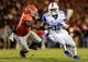 Nov 23, 2013; Athens, GA, USA; Kentucky Wildcats running back Dyshawn Mobley (33) runs the ball past Georgia Bulldogs linebacker Amarlo Herrera (52) in the second half at Sanford Stadium. The Georgia Bulldogs won 59-17. Mandatory Credit: Daniel Shirey-USA TODAY Sports