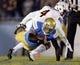Nov 23, 2013; Pasadena, CA, USA; UCLA Bruins quarterback Brett Hundley (17) dives for extra yards past Arizona State Sun Devils safety Alden Darby (4) during the second half at Rose Bowl. Mandatory Credit: Robert Hanashiro-USA TODAY Sports