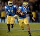 Nov 23, 2013; Pasadena, CA, USA; UCLA Bruins quarterback Brett Hundley (17) scrambles for a first down during second half action against Arizona State Sun Devils at Rose Bowl. UCLA lost 38-33. Mandatory Credit: Robert Hanashiro-USA TODAY Sports