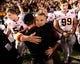 Nov 23, 2013; Pasadena, CA, USA; Arizona State Sun Devils head coach Todd Graham gets a hug after the Sun Devils beat the UCLA Bruins at Rose Bowl. Mandatory Credit: Robert Hanashiro-USA TODAY Sports