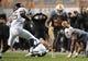 Nov 23, 2013; Knoxville, TN, USA; Tennessee Volunteers running back Rajion Neal (20) runs the ball against Vanderbilt Commodores linebacker Darreon Herring (35) at Neyland Stadium. Vanderbilt won 14 to 10. Mandatory Credit: Randy Sartin-USA TODAY Sports