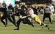 Nov 23, 2013; Boulder, CO, USA; Colorado Buffaloes quarterback Sefo Liufau (13) is tackled by Southern California Trojans linebacker Devon Kennard (42) in the second quarter at Folsom Field. Mandatory Credit: Ron Chenoy-USA TODAY Sports