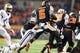 Nov 23, 2013; Corvallis, OR, USA; Washington Huskies linebacker Cory Littleton (42) tackles Oregon State Beavers wide receiver Victor Bolden (6) during a kickoff return in the first half at Reser Stadium. Mandatory Credit: Jaime Valdez-USA TODAY Sports