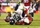 Oct 17, 2013; Phoenix, AZ, USA; Seattle Seahawks running back Marshawn Lynch (24) is tackled by Arizona Cardinals safety Yeremiah Bell (37) at University of Phoenix Stadium. Mandatory Credit: Mark J. Rebilas-USA TODAY Sports