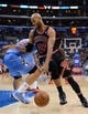 Nov 24, 2013; Los Angeles, CA, USA;  Chicago Bulls power forward Taj Gibson (22) drives past Los Angeles Clippers power forward Blake Griffin (32) in the second half of the game at Staples Center. Clippers won 121-82. Mandatory Credit: Jayne Kamin-Oncea-USA TODAY Sports