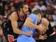 Nov 24, 2013; Los Angeles, CA, USA;  Chicago Bulls center Joakim Noah (13) fouls Los Angeles Clippers power forward Blake Griffin (32) in the second half the game at Staples Center. Clippers won 121-82. Mandatory Credit: Jayne Kamin-Oncea-USA TODAY Sports