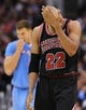 Nov 24, 2013; Los Angeles, CA, USA;  Chicago Bulls power forward Taj Gibson (22) holds his head after being fouled by Los Angeles Clippers power forward Blake Griffin (32) in the second half the game at Staples Center. Clippers won 121-82. Mandatory Credit: Jayne Kamin-Oncea-USA TODAY Sports