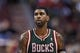 Nov 22, 2013; Philadelphia, PA, USA; Milwaukee Bucks guard O.J. Mayo (00) during the third quarter against the Philadelphia 76ers at Wells Fargo Center. The Sixers defeated the Bucks 115-107 in overtime. Mandatory Credit: Howard Smith-USA TODAY Sports