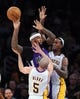 Nov 24, 2013; Los Angeles, CA, USA;  Los Angeles Lakers point guard Steve Blake (5) and Los Angeles Lakers center Jordan Hill (27) guard Sacramento Kings center DeMarcus Cousins (15) during the game at Staples Center. Lakers won 100-86. Mandatory Credit: Jayne Kamin-Oncea-USA TODAY Sports