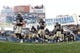 Nov 16, 2013; Pittsburgh, PA, USA; The Pittsburgh Panthers take the field against the North Carolina Tar Heels during the first quarter at Heinz Field. North Carolina won 34-27.  Mandatory Credit: Charles LeClaire-USA TODAY Sports