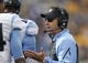 Nov 16, 2013; Pittsburgh, PA, USA; North Carolina Tar Heels head coach Larry Fedora (right) reacts on the sidelines as he talks to his players against the Pittsburgh Panthers during the second quarter at Heinz Field. North Carolina won 34-27. Mandatory Credit: Charles LeClaire-USA TODAY Sports