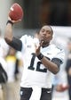 Nov 16, 2013; Pittsburgh, PA, USA; North Carolina Tar Heels quarterback Marquise Williams (12) warms up on the sideline against the Pittsburgh Panthers during the third quarter at Heinz Field. North Carolina won 34-27. Mandatory Credit: Charles LeClaire-USA TODAY Sports