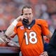 Oct 13, 2013; Denver, CO, USA; Denver Broncos quarterback Peyton Manning (18) talks on a phone during the game against the Jacksonville Jaguars at Sports Authority Field at Mile High. Mandatory Credit: Chris Humphreys-USA TODAY Sports