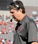 Nov 16, 2013; Tucson, AZ, USA; Washington State Cougars head coach Mike Leach walks to the sideline during the second quarter against the Arizona Wildcats at Arizona Stadium. The Cougars beat the Wildcats 24-17. Mandatory Credit: Casey Sapio-USA TODAY Sports