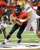 Nov 9, 2013; Tucson, AZ, USA; Arizona Wildcats quarterback B.J. Denker (7) gets tackled during the third quarter against the UCLA Bruins at Arizona Stadium. Mandatory Credit: Casey Sapio-USA TODAY Sports