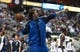 Nov 18, 2013; Dallas, TX, USA; Dallas Mavericks forward Dirk Nowitzki (41) points as he shoots a full court shot prior to the second half against the Philadelphia 76ers at American Airlines Center. Mandatory Credit: Matthew Emmons-USA TODAY Sports