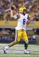 Aug 31, 2013; Arlington, TX, USA; LSU Tigers quarterback Zach Mettenberger (8) throws in the pocket against Texas Christian Horned Frogs at AT&T Stadium. Mandatory Credit: Matthew Emmons-USA TODAY Sports