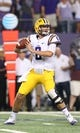 Aug 31, 2013; Arlington, TX, USA; LSU Tigers quarterback Zach Mettenberger (8) throws in the first quarter against Texas Christian Horned Frogs at AT&T Stadium. Mandatory Credit: Matthew Emmons-USA TODAY Sports