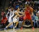 Nov 25, 2013; Memphis, TN, USA; Houston Rockets power forward Dwight Howard (12) is guarded by Memphis Grizzlies center Kosta Koufos (41) during the second quarter at FedExForum. Mandatory Credit: Justin Ford-USA TODAY Sports