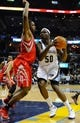 Nov 25, 2013; Memphis, TN, USA; Houston Rockets power forward Terrence Jones (6) guards Memphis Grizzlies power forward Zach Randolph (50) during the second quarter at FedExForum. Mandatory Credit: Justin Ford-USA TODAY Sports