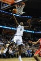 Nov 25, 2013; Memphis, TN, USA; Memphis Grizzlies shooting guard Tony Allen (9) lays the ball up against the Houston Rockets during the second quarter at FedExForum. Mandatory Credit: Justin Ford-USA TODAY Sports
