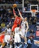 Nov 25, 2013; Memphis, TN, USA; Houston Rockets power forward Dwight Howard (12) shoots the ball over Memphis Grizzlies center Kosta Koufos (41) during the second quarter at FedExForum. Mandatory Credit: Justin Ford-USA TODAY Sports