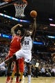 Nov 25, 2013; Memphis, TN, USA; Memphis Grizzlies power forward Zach Randolph (50) lays the ball up over Houston Rockets power forward Terrence Jones (6) during the second quarter at FedExForum. Mandatory Credit: Justin Ford-USA TODAY Sports