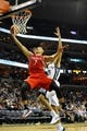 Nov 25, 2013; Memphis, TN, USA; Houston Rockets point guard Jeremy Lin (7) lays the ball up against Memphis Grizzlies small forward Tayshaun Prince (21) during the third quarter at FedExForum. Mandatory Credit: Justin Ford-USA TODAY Sports