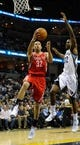 Nov 25, 2013; Memphis, TN, USA; Houston Rockets shooting guard Francisco Garcia (32) lays the ball up over Memphis Grizzlies power forward Ed Davis (32) during the fourth quarter at FedExForum. Mandatory Credit: Justin Ford-USA TODAY Sports