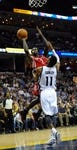 Nov 25, 2013; Memphis, TN, USA; Houston Rockets point guard Patrick Beverley (2) shoots the ball over Memphis Grizzlies point guard Mike Conley (11) during the fourth quarter at FedExForum. Houston Rockets beat the Memphis Grizzlies 93-86. Mandatory Credit: Justin Ford-USA TODAY Sports