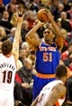 Nov 25, 2013; Portland, OR, USA; New York Knicks small forward Metta World Peace (51) shoots over Portland Trail Blazers center Joel Freeland (19) at the Moda Center. Mandatory Credit: Craig Mitchelldyer-USA TODAY Sports