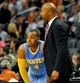 Nov 8, 2013; Phoenix, AZ, USA; Denver Nuggets head coach Brian Shaw and shooting guard Randy Foye (4) talk strategy during the third quarter against the Phoenix Suns at US Airways Center. Mandatory Credit: Casey Sapio-USA TODAY Sports
