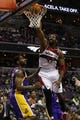 Nov 26, 2013; Washington, DC, USA; Washington Wizards power forward Nene Hilario (42) dunks the ball as Los Angeles Lakers power forward Shawne Williams (3) watches in the second quarter at Verizon Center. Mandatory Credit: Geoff Burke-USA TODAY Sports