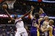 Nov 26, 2013; Washington, DC, USA; Washington Wizards power forward Nene Hilario (42) shoots the ball around Los Angeles Lakers center Pau Gasol (16) in the first quarter at Verizon Center. The Wizards won 116-111. Mandatory Credit: Geoff Burke-USA TODAY Sports